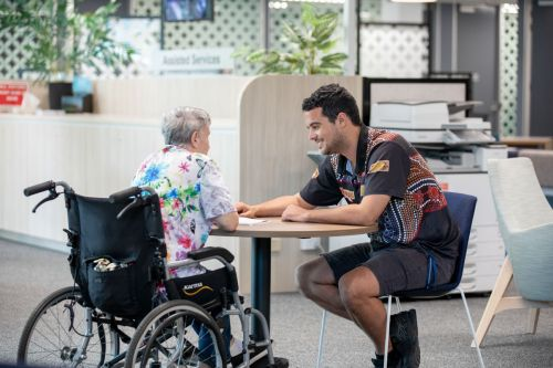 2.A Housing Officer talks to a person with disability.